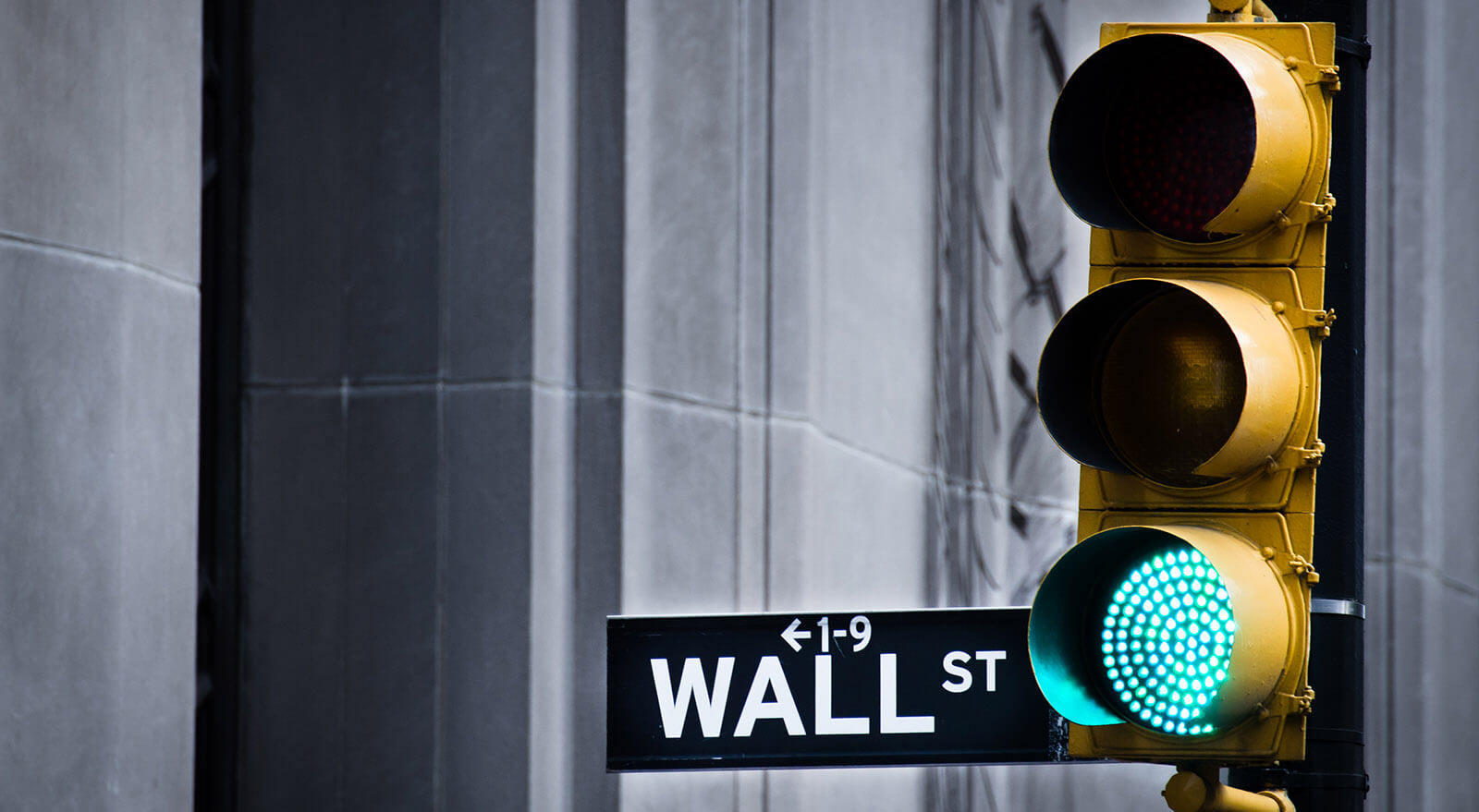 Green traffic light at the beginning of Wall Street, New York
