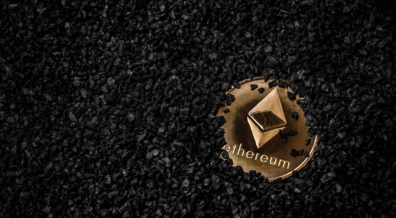 ethereum coin covered in coal