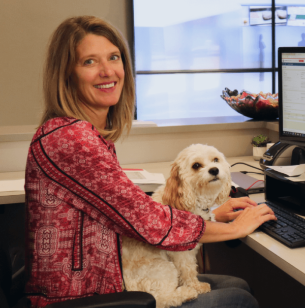 woman and dog working